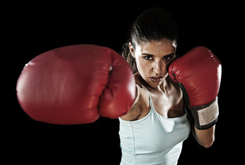 latin fitness woman with girl red boxing gloves posing in defiant and competitive fight attitude