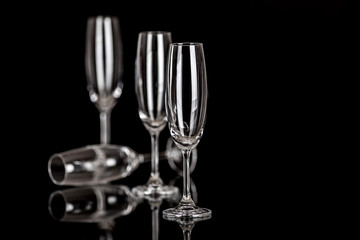 Champagne glasses isolated on black