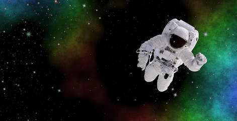 Astronaut in deep space. Discovering the mysterious parts of the universe. Elements of this image furnished by NASA.