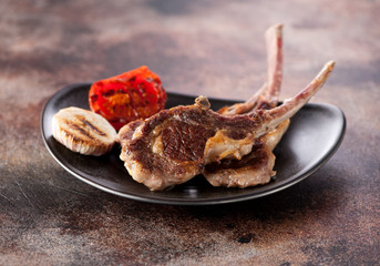 Roasted lamb cutlets ribs with garlic and tomato