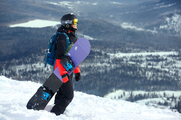 Beautiful young girl with a snowboard