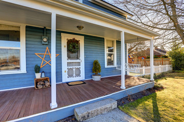 Home exterior with Classic Northwest Charm features blue siding