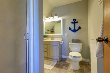 Marine style bathroom interior in soft tones