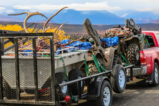 Huntsmen pick up truck on the way back with equipment and trophies, Richardson Highway, Alaska