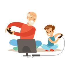 Grandfather And Boy Playing Video Games, Part Of Grandparents Having Fun With Grandchildren Series