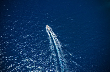 Aerial view of small boat flowing in sea
