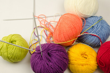 Balls of colored yarn, knitting needles