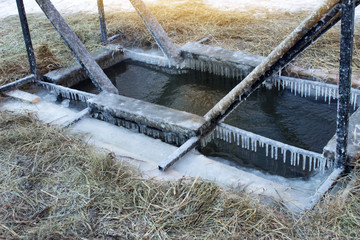 On the frozen river, cut a hole in the ice for bathing on the day of the baptism on January 19
