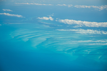 View from the plane to the city of Cancun, Mexico. Beautiful Ocean, the Caribbean Sea. View from above, top view