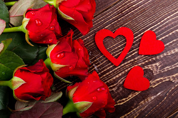 Hearts and water dropped roses. Flowers in dew on wood. Blossom of love. Best selling gift.