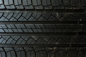 Close up on a tire on a dark background
