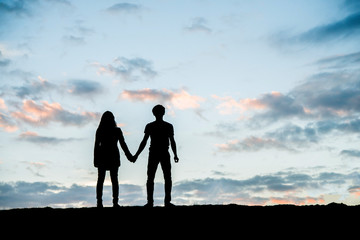 Happy young couple together against beautiful sunset. Freedom, e