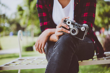 Close-up of hipster woman with vintage camera.