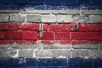 painted national flag of costa rica on a brick wall
