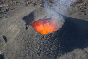 Erupting volcano, molten magma. Reunion island, France