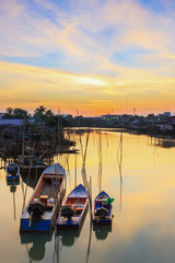 Small fishing boats with sunrise at fisherman village