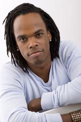 Stylish African American man with dreadlocks.