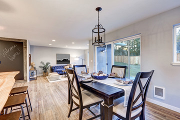 Open plan dining room interior with light wood floors