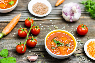 Vegetable Soups with Cooking Ingredients on Wooden Background
