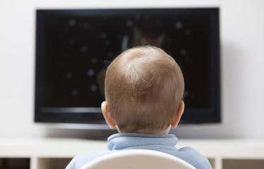 Baby boy watching cartoons on TV