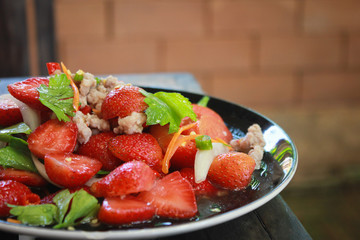 strawberry in Spicy Salad. the food art of thailand.