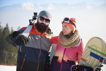 Young couple on the ski trip