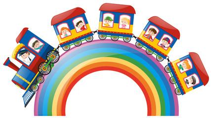 Children riding on train over rainbow