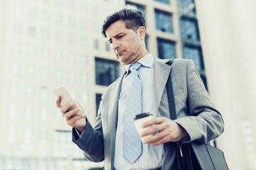 Businessman using a smart phone.