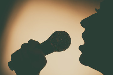 Woman singing to microphone