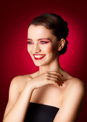 Portrait of beautiful sexy fashion model with red make up over r