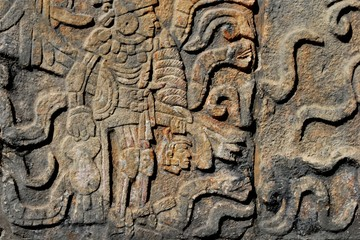 Detail of Mayan wall carving with warrior
