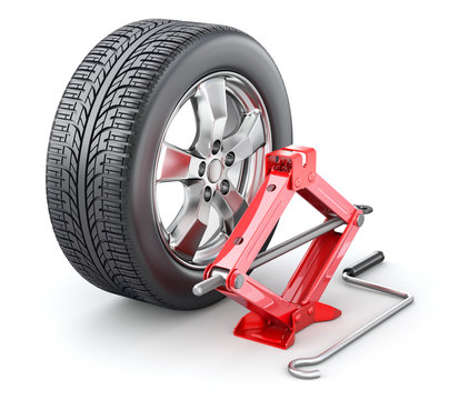 Car wheel with red scissor jack on white background