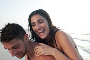 Expat couple having fun at beach.