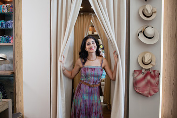 Portrait of woman at dressing room of boutique.