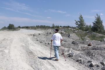 Nordic Walking - elderly woman is hiking  in the summer