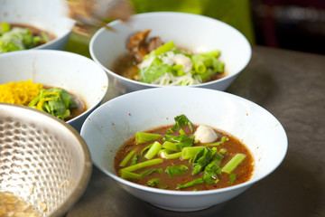 prepare noodle with hot boiled soup in Thailand street food