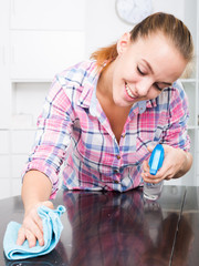 portrait of young woman cleaning