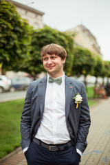 Young attractive groom near the castle