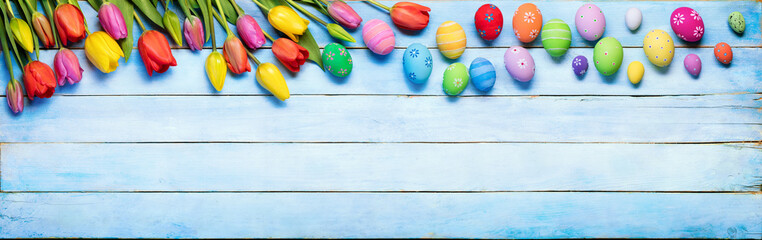 Easter Eggs And Tulips On Blue Wooden Plank