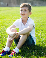 boy sitting grass