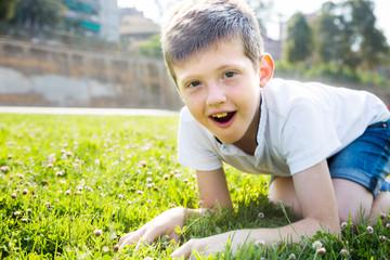 boy sitting grass