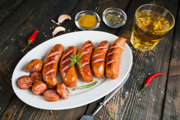Grilled sausages with spices and beer