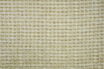 white-gray fabric with visible lines of threads and a cross-style pattern Close-up on gray background full frameed