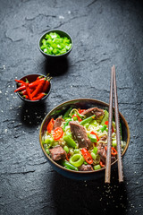 Hot asian noodle with beef chilli peppers