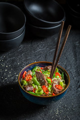 Spicy asian noodle with vegetables and beef