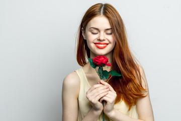 red flower and attractive woman with closed eyes