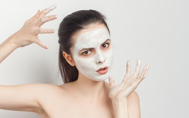 mask on face, woman gesturing with hands
