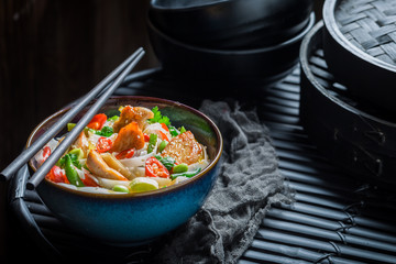 Tasty noodle with chicken, vegetables and chili peppers