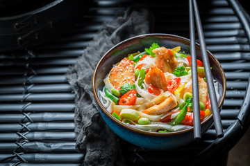 Tasty noodle with vegetables, chicken and chili peppers