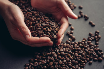 coffee beans in hands